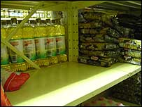 An empty shelf in a downtown Caracas supermarket, normally used to stock sugar and coffee