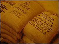 Sacks of unroasted coffee beans in a warehouse