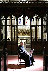 Reverend Kimber at work on his computer in St John's Church