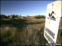 A warning sign is displayed at Pejar Dam, one of the main water supply reservoirs for Goulburn May 11, 2005 in Goulburn, Australia.