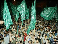 Hamas supporters protest outside the Palestinian parliament in Gaza