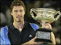 Marat Safin poses with the Australian Open title last year