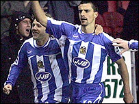 Wigan's Paul Scharner celebrates scoring the only goal of the game
