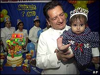 Dr Luis Rubio with Milagros on first birthday