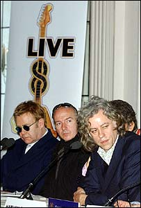 Bob Geldof (right), Midge Ure (centre) and Elton John