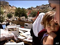 Palestinian residents of Silwan watch Israeli bulldozers destroying their homes
