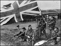UK troops raising a British flag in the Falkland Islands during the war in 1982