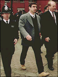 Eric Cantona (centre) entering Croydon Magistrates Court