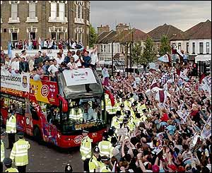 The West Ham boss makes its way through the streets