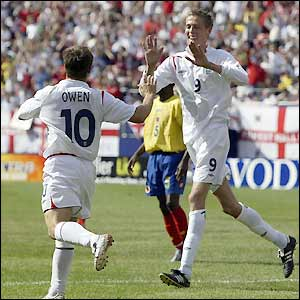 Peter Crouch celebrates with Michael Owen as a 2-0 lead is opened up