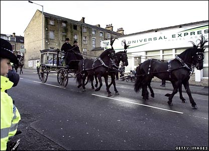 The funeral cortege makes its way along the streets of Bradford