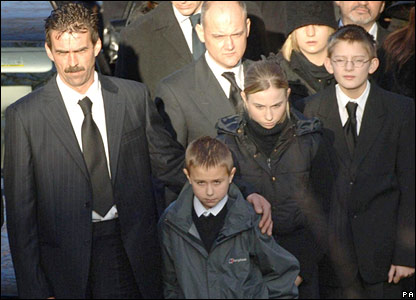 Pc Beshenivsky's husband and children at the funeral