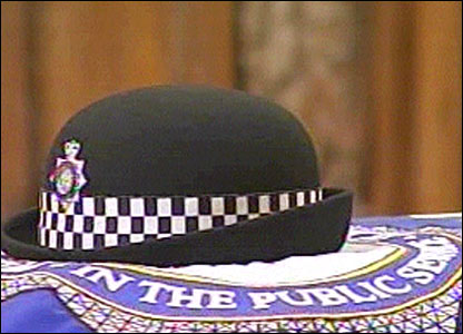 A police hat on Pc Beshenivsky's coffin in Bradford Cathedral