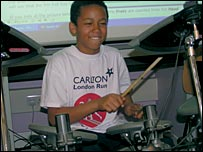Child playing drums at Creative Bett