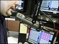 Radio DJ talking into microphone