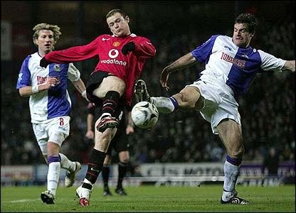 Rooney has a shot blocked by Blackburn's Ryan Nelsen