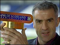 Craig Brewster with his Bank of Scotland award