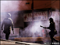 Police use tear gas to disperse protesters in the Bolivian capital, La Paz