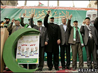Hamas' candidates for the Palestinian Legislative Council wave during a rally in Gaza