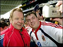 Lions manager Bill Beaumont has his photo taken with a fan