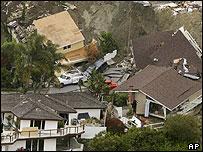 Homes damaged by a landslide in Laguna Beach, California