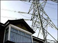 house and electricity pylon