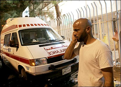 Palestinian man on phone outside hospital