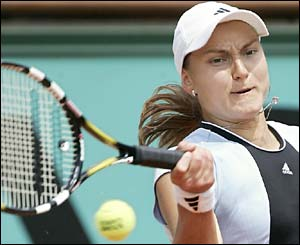 Russia's Nadia Petrova plays a forehand