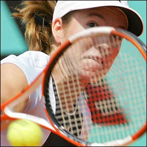 Justine Henin-Hardenne plays a backhand