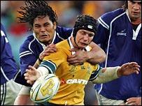 Samoa's Alesana Tuilagi tackles Australia's Stephen Larkham