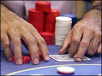 Poker player with stack of chips