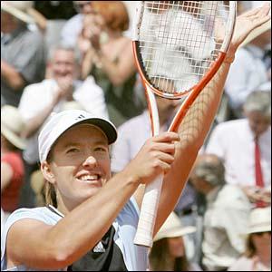 Henin-Hardenne celebrates victory over Nadia Petrova