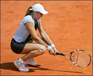 Russia's Nadia Petrova sits on her paunches