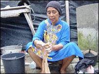 Ibu Mariani washing clothes