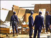 Police stand near demolished house