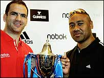 Martin Johnson and Jonah Lomu pose with the Nobok Challenge trophy