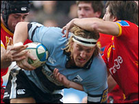 Blues back row Andy Powell tests the Perpignan defence