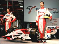 Jarno Trulli and Ralf Schumacher pose with the new Toyota Formula One car