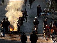 Residents walk along a blocked road during a public transport strike in El Alto.
