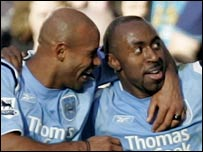 Darius Vassell (r) celebrates scoring City's second goal with Trevor Sinclair