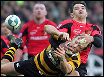 Wasps' Mark van Gisbergen is wrapped up by Toulouse's Florian Fritz