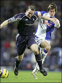 Kevin Davies and Morten Gamst Pedersen battle for possession