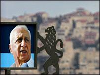 A billboard shows Ariel Sharon against the backdrop of Jerusalem