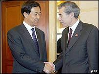 Bo Xilai (left) and  Carlos Gutierrez