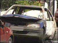Car destroyed by petrol bomb