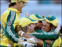 Australia's players mob Andrew Symonds after he brilliantly runs out Jacques Kallis