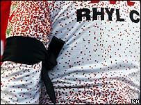 Member of Rhyl Cycling Club wears black armband