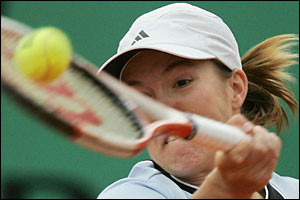 Justine Henin-Hardenne plays a shot