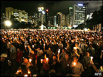 crowd with candles in Hong Kong