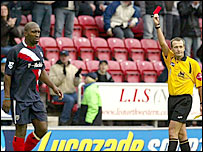 Darren Moore trudges off after his red card